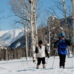 Skiing, snowshoeing, tubing, and sleigh rides are all part of winter vacations at the ranch