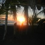 Sunset from the thatched hut on their beach