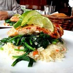 Grilled Salmon on a bed of spinach and rice.