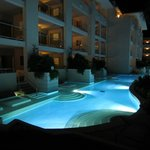 Night view onto the swim up suites
