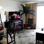 living room and sliding glass door to ocean-view balcony