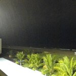 a rainy night view over the beach bar area from our balcony