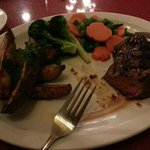 10oz Sirloin Steak with seasonal vegetables and Cajun cut potatoes.