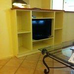 TV/kitchen area of 2 bedroom apartment