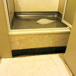 Shower tray perched 12 inches above the ground!