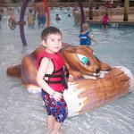 Wild Waterdome area behind him is the wave pool
