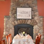Dining area with beautiful rock fireplace.