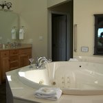 2-person jacuzzi tub right off bedroom.  Note the aromatherapy fireplace over the tub.