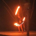 fire dancing at the beach party
