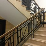 The staircase with beautiful brass handrail and metalwork