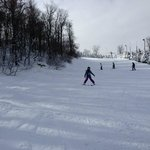 Skiing down a blue trail with instructor