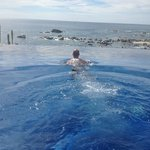 my husband in the infinity pool overlooking the ocean.  whale watching!