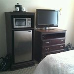 TV and appliances at foot of bed