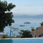View from Top pool over the water to bali and Mt Agung