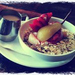 Home made Muesli with poached fruit