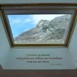 Hotel room, view through the roof window on the mountains