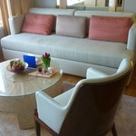 """The large sofa in the """"living room"""" area"""