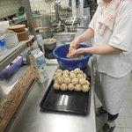 Frau Meier in kitchen making dumplings