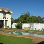 Guest House, Pool, Perimeter fence and floral bushes