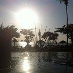 Sun setting by pool