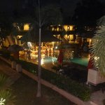View from my rooms balcony of pool and pool bar at night