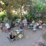 Breakfast area in courtyard below rooms