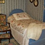 Blue Spruce guest room with one twin bed and queen bed