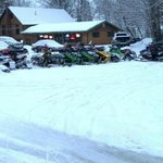 Snowmobiles outside Bar & Grill