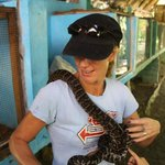 Michelle with a snake from Rudy's garden. Part of our Stand up paddle board tour in La Boca
