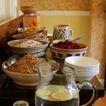 Breakfast buffet including home made granola, muesli and berry compote.