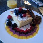 Blintz souffle with fresh berries.