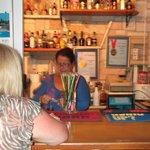 Elizabeth serving behind the bar