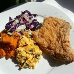 Pork Chop entree with cabbage, roasted sweet potatoes, and grits casserole