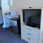 Flat Screen TV, Fridge, Microwave, Closet area