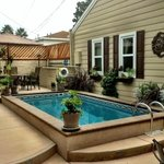 Part of the very attractive pool/patio area