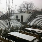 View from the Breakfast room across snowy roofs to 'Yang' room.