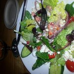 Greek salad with grilled salmon