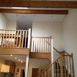 mezzanine floor with upper bedroom and bathroom