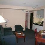 Two bedroom suite - Lounge and small kitchen look towards bedroom doors