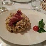 risotto con carciofi taleggio funghi crudo e grana