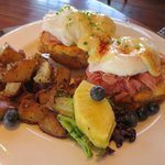 Eggs Benedict with shaved ham and fresh fruit