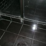 Filthy floor and shower tray room 202