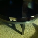 Chunks of wood missing from the coffee table in a Monaco Suite