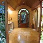 The fabulous bathroom of the Palm Villa.. Look at these stained glass doors!