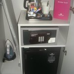 Safe, iron and board and tea tray, all in the small wardrobe!