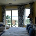 Bedroom with partial view of ocean.