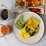 An omelet made from our own eggs and produce, local coffee and fresh juice.
