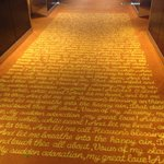 Gorgeous carpet with gilded writing