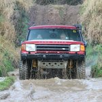 Exiting the water splash in our modified Land Rover!