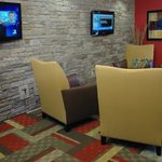 Spacious Lobby with stonewall and flat screens